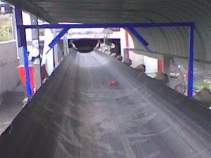 Qwikmount Installation System bracket mounted over conveyor belt.